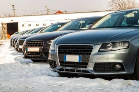 cars sitting in a lot for year